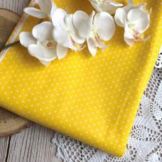 Ткань горошек мелкий на жёлтом фоне