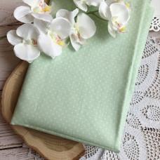 Ткань горошек мелкий на бледно-зелёном фоне